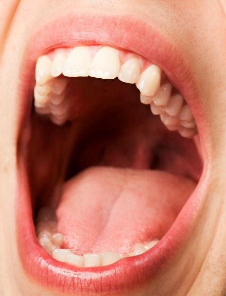 Oral cancer screening exam includes checking your throat