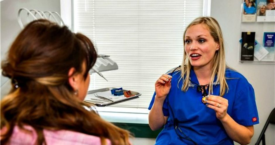 Dr Thyra Jagger consulting with a dental patient