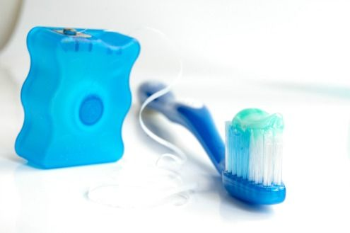 Brushing and flossing teeth help prevent cavities